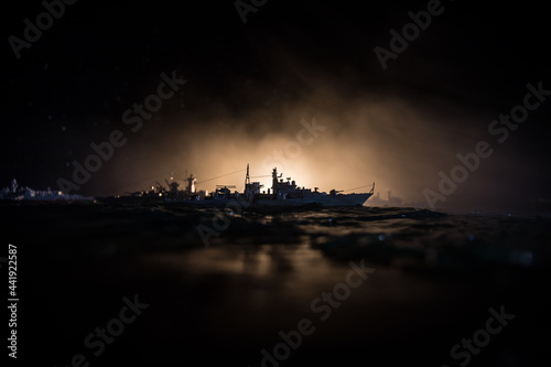 Silhouettes of a crowd standing at blurred military war ship on foggy background Fototapete