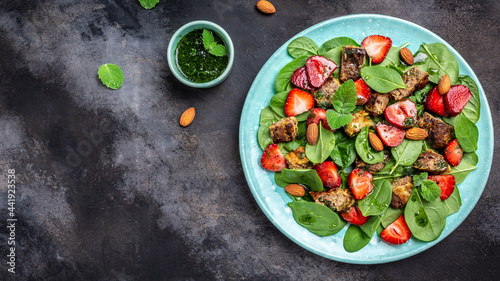 Fotografie, Obraz Strawberry with Spinach salad with chicken liver, almond and mint