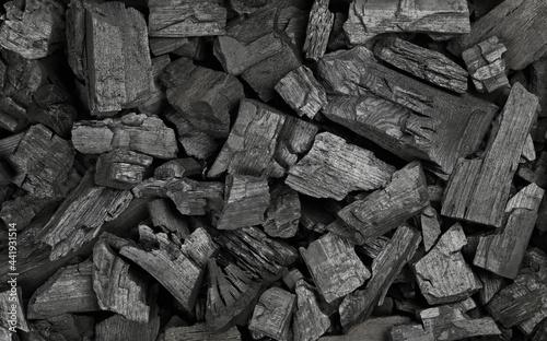 Murais de parede Background texture of many black charcoal pieces