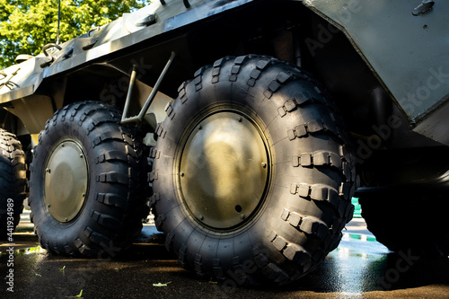 Murais de parede Close-up of the large wheels of a combat vehicle.Military concept