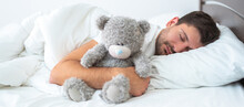 The Man Sleeping With A Soft Toy On The White Background