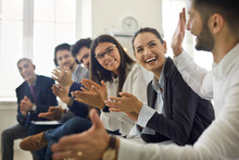 Group Of People Thanking Speaker For Interesting Presentation In Professional Business Conference Or Seminar. Team Of Happy Male And Female Company Workers Applauding Colleague In Corporate Meeting