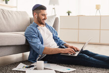 Smiling Male Jew Working On Laptop At Home