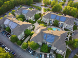 Fototapeta Kawa jest smaczna - aerial view of apartment buildings with solar panel installed on roof