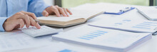 Man Analysis Business Accounting Working WithIndividual Income Tax Return.Accounting