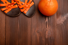 Summer Background Of Women's Sandals, Orange On A Wooden Surface