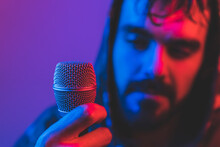Brutal Man Singing With Microphone In Neon Lights