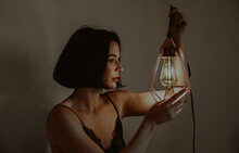 Woman With Glowing Lantern In Room