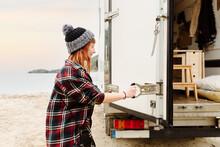 Traveling Woman Opening Van At Lakeside