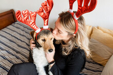 Content Woman Embracing Fox Terrier In House