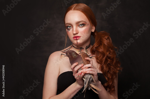 Fototapeta Woman with bird, soul concept