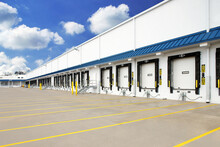 Exterior Of Warehouse Industrial Building With Semi Truck Loading Dock