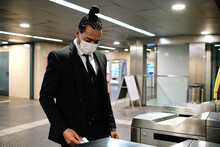 Black Businessman Passing Through Turnstile In Subway