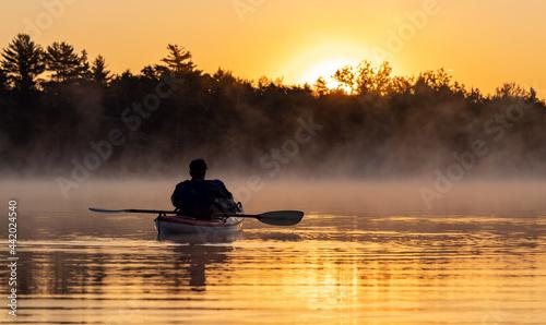 Fotografie, Obraz A kayaker at sunrise