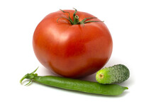 A Large Tomato, A Small Cucumber And A Pod Of Young Green Peas. Fresh Vegetables Isolated On White Background.