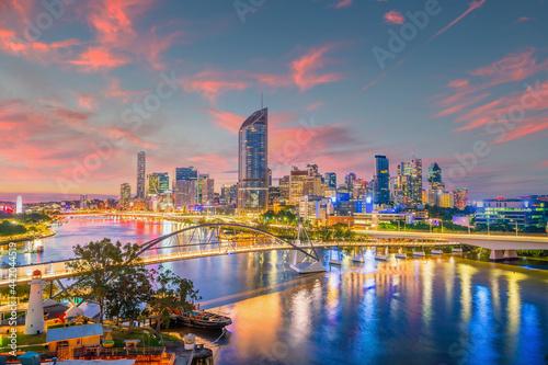 Obraz na plátně Brisbane city skyline and Brisbane river at sunset