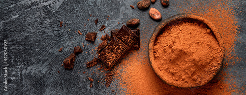 Cuadros en Lienzo Cacao beans and chocolate on gray background. Superfood concept.