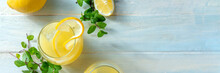 Lemonade Panorama With Copy Space. Homemade Fresh Lemon Beverage, Shot From Above On A Wooden Background With A Place For Text. Healthy Organic Detox Panoramic Banner