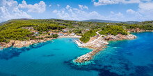Panoramic Aerial View To The Coast And Little Fishing Village Of Katigiorgis, South Pelion, Greece, With Turquoise Sea