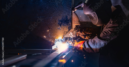 Industry banner, professional worker welder in protect mask use erecting technical iron at work