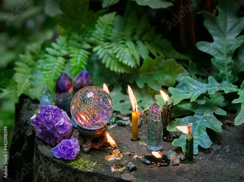 candles, minerals, magic crystal ball in forest, natural background Fotobehang