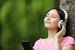 Leinwandbild Motiv Korean woman listening to music with headphones