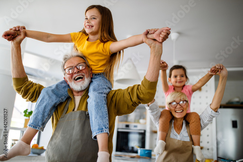 Fotografie, Obraz Cheerful family spending good time together while cooking in kitchen
