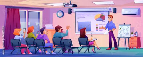 Fotografia Students listening to professor or teacher in modern classroom