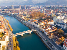 Panoramic Aerial View Of Grenoble City With Bridge Over Isere River, France