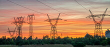 High Voltage Pylons Against The Background Of The Evening Sky