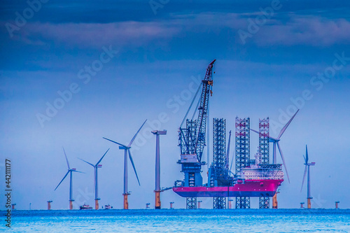 Fototapeta Gwynt y Mor. Offshore vessel at the windfarm.