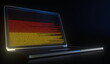 Leinwandbild Motiv Open laptop and computer code on the screen composing flag of Germany. Modern information technology related 3d rendering