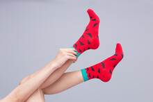 Woman's Legs Are Raised And Wearing Red Socks With Black Polka Dots