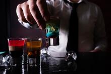 Barman Preparing Cocktail Shots At The Bar Counter. Barman Mixing Drinks At The Night Club..