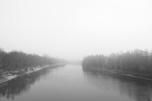 River Surrounded By Forest During Fog. Minimal Composition, Monochrome Image. Place For Text