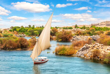 Aswan In Egypt, Traditional Felucca In Lake Nasser Of The Nile