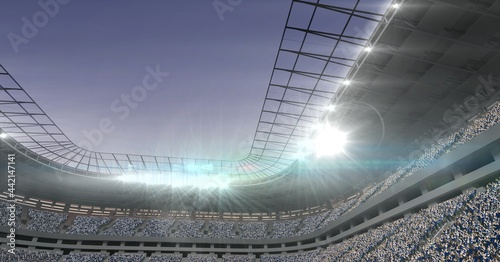 Composition of sports stadium with glowing spotlights and copy space