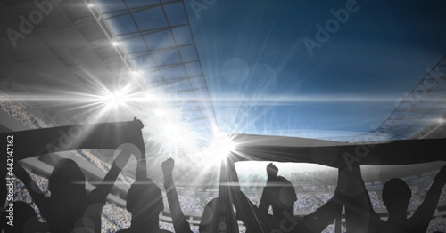 Composition of sports fans with scarfs in sports stadium with glowing spotlights and copy space