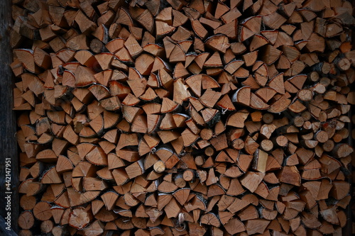 Obraz na plátně Logs of firewood piled under canopy, closeup.