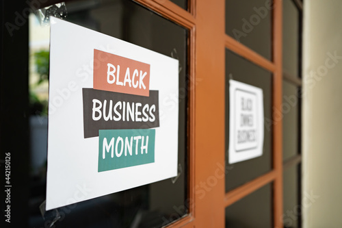Fotografering black business month sign was attached on the window