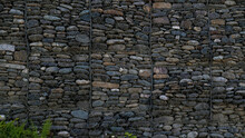 Gabion Retaining Wall - Grey Stones In Gabion Metallic Baskets Kept By Retaining Wall. Backdrop Design And Eco Wall And Die-cut For Artwork.