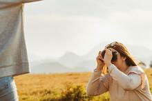 Women Having Fun In Nature And Taking Photos
