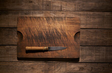 Knife And Cutting Board On Table