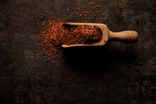Red Dried Spices In Wooden Scoop