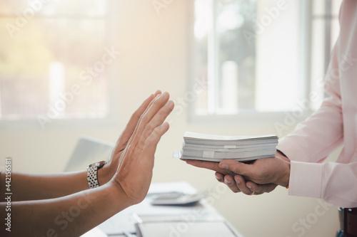 Obraz na plátne Business man refusing money to take the bribe