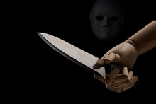 Anonymous Person In Mask With Wooden Hand With Sharp Knife