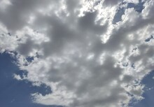 A Mass Of Fluffy Cloud Covering The Sky