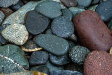 Abstract Background Texture Of Multicolored Beautiful Stones. Beautiful Wet Pebbles.