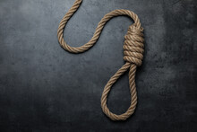 Rope Noose With Knot On Black Table, Top View