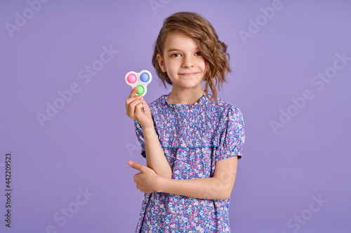 Fototapeta Picture of little girl with a modern popit toy